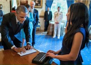 Haben Girma and Barack Obama communicating through