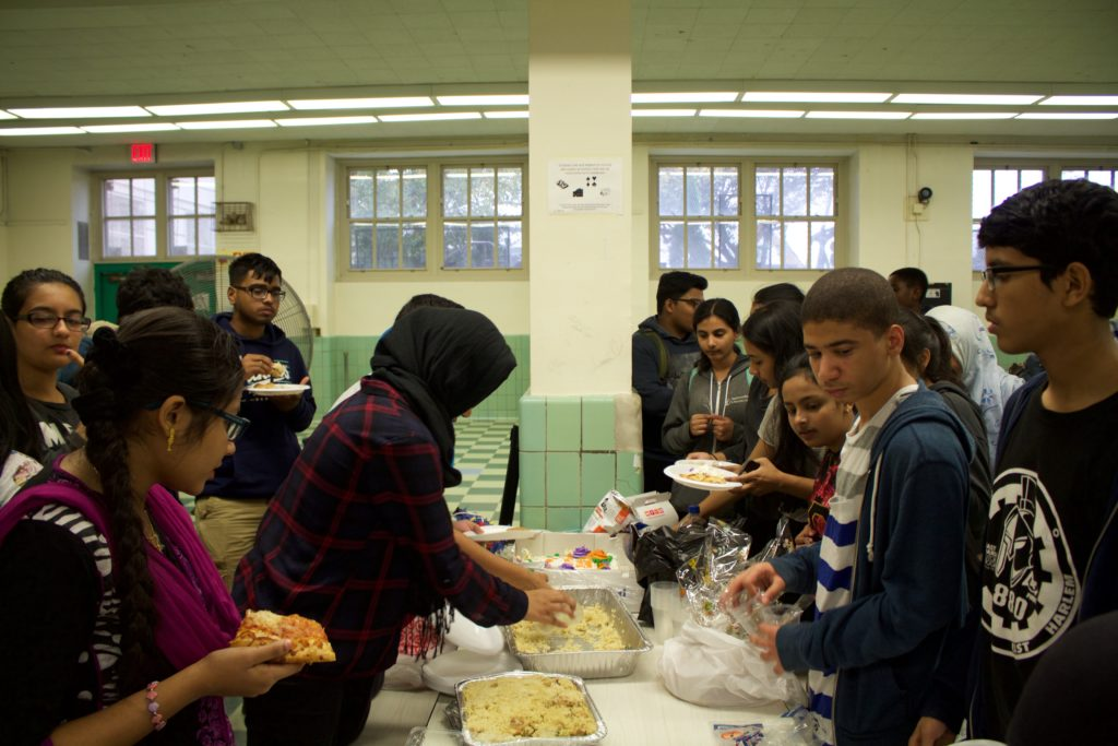 Enjoying food at the Eid party in the MCSM cafeteria.
